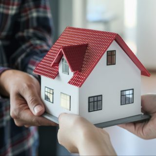 Real Estate Agents Giving Homes to Customers. Concepts of real estate and land.